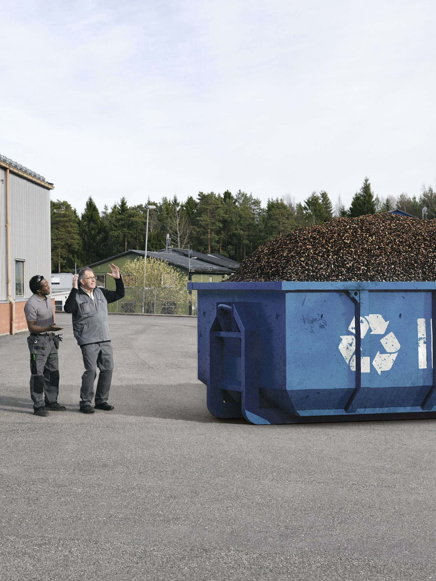People_Standing_In_Front_Of_Recycling_Container.tif