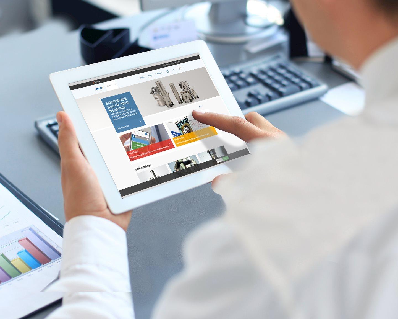 Businessman_Holding_Digital_Tablet_desk pad.tif